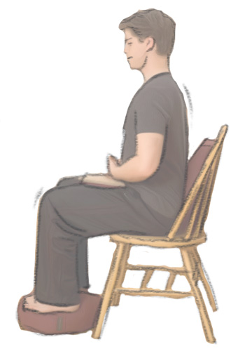 A simple high backed chair really helps create good meditation posture.